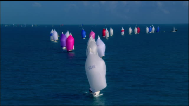 low aerial multicolored sailboats in ocean / key west, florida, usa - sailing boat stock videos & royalty-free footage