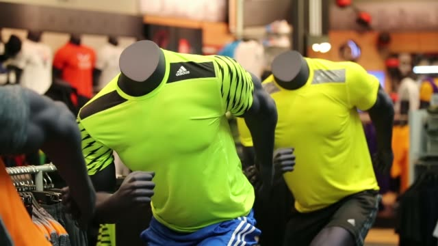 multicolored sports clothing sits on display on mannequins inside the adidas ag sportswear store in moscow, russia, on friday, may 2 adidas running t... - adidas stock videos & royalty-free footage