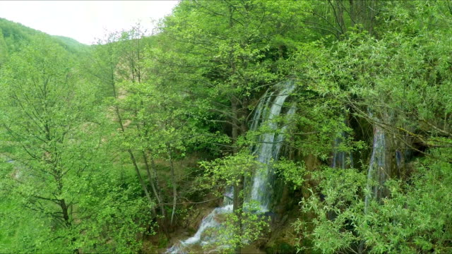 multicopter aerial shot of beautiful waterfall - multicopter stock videos & royalty-free footage