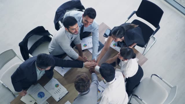 multicultural business people meeting in modern conference room,discussion strategy working,start up business concept.top view footage.crap the hand and shake hand after success business agreement. - formal businesswear stock videos & royalty-free footage