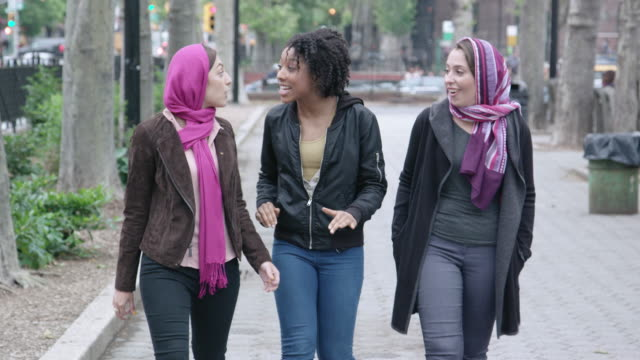 multi-cultural female friends walk in the city - hijab stock videos and b-roll footage