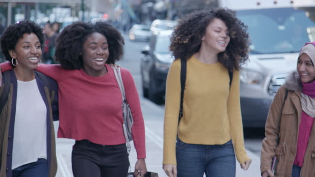 multi-cultural female friends walk in the city - african american ethnicity stock videos & royalty-free footage