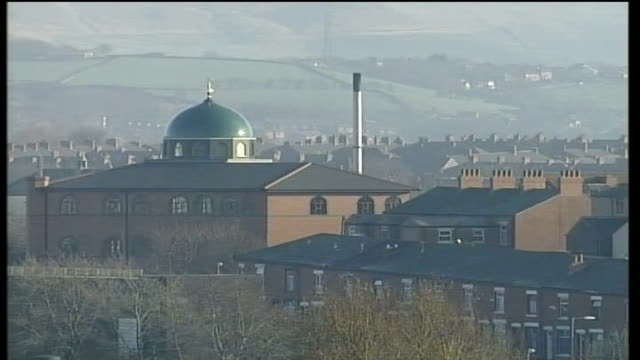 ruth kelly statement; england: greater manchester: oldham: ext oldham skyline with rooftops of terraced houses dome of mosque on skyline amid rooves... - steeple stock videos & royalty-free footage