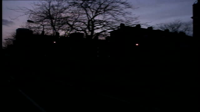 ruth kelly statement; tx 2.5.2001 waltham forest: ext / night blocks of council flats seen from moving car ) group of muslim youths stand on street... - multiculturalism stock videos & royalty-free footage