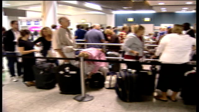 ruth kelly statement tx august 2006 heathrow airport delayed passengers queueing at checkin desks some carrying transparent plastic hand luggage bags - multiculturalism stock videos & royalty-free footage