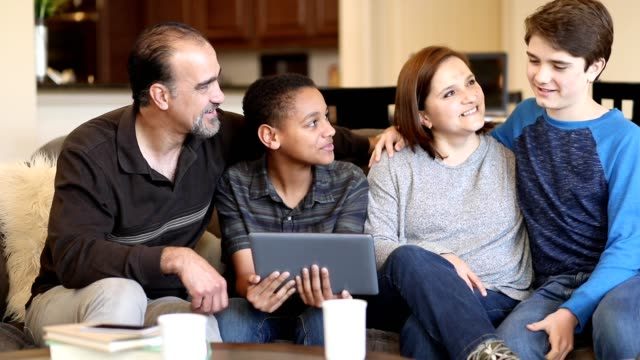 multi-ethnic, adoption or foster care family at home. - foster care stock videos & royalty-free footage