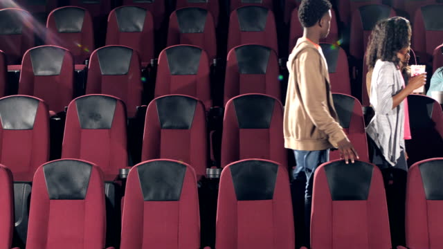 multi-ethnic audience leaving theater after movie ends - pacific islander man stock videos & royalty-free footage