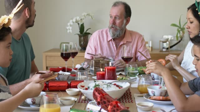 multi-ethnic australian family celebrating christmas lunch - meal stock videos & royalty-free footage