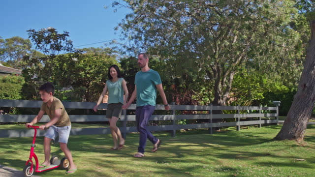 Multi-ethnic Australian parents and son going for a walk at suburban Sydney