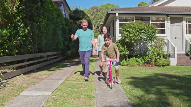 multi-ethnic australian parents and son going for a walk in the neighbourhood - two parents stock videos & royalty-free footage