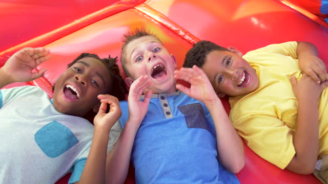 multi-ethnic boys playing in bounce house - 8 9 years stock videos & royalty-free footage