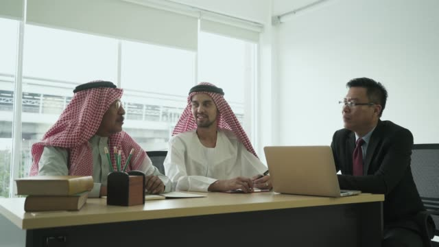 multiethnic business partners having discussion in the meeting - saudi arabia stock videos & royalty-free footage