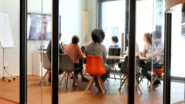 vídeos y material grabado en eventos de stock de multi-ethnic business people attending video conference in office - conferencia telefonica