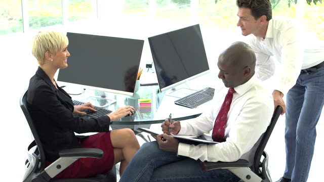 Multi-ethnic business people meeting, using computers