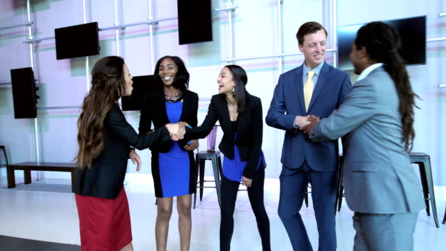 multi-ethnic business people shaking hands - mixed race person stock videos & royalty-free footage