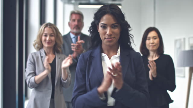 multi-ethnic business team applauding to the camera - applaudire video stock e b–roll