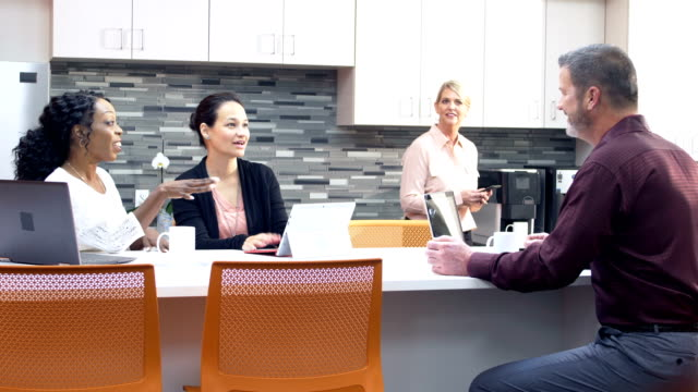 multi-ethnic businesspeople working in shared office - coffee break stock videos & royalty-free footage