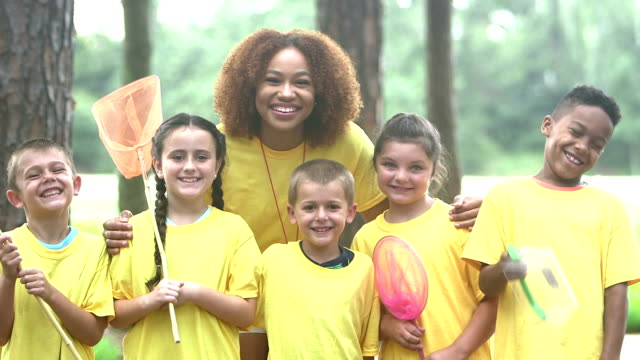 multi-ethnic children and counselor at summer camp - summer camp helper stock videos & royalty-free footage