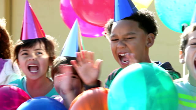 multi-ethnic children at birthday party - party hat stock videos & royalty-free footage