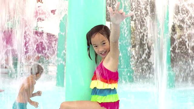 multi-ethnic children at water park playing, splashing - water slide stock videos & royalty-free footage