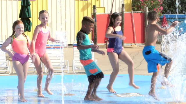 multi-ethnic children at water park playing - children only stock videos and b-roll footage