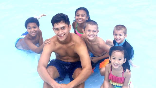 multi-ethnic children, counselor at summer camp in pool - 8 9 years stock videos & royalty-free footage