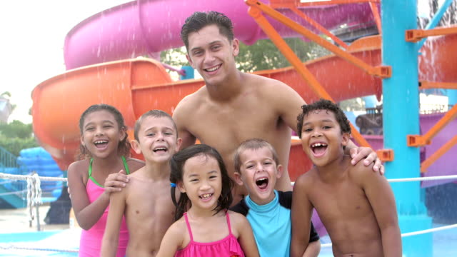 multi-ethnic children, counselor at water park by slide - pacific islander family stock videos & royalty-free footage