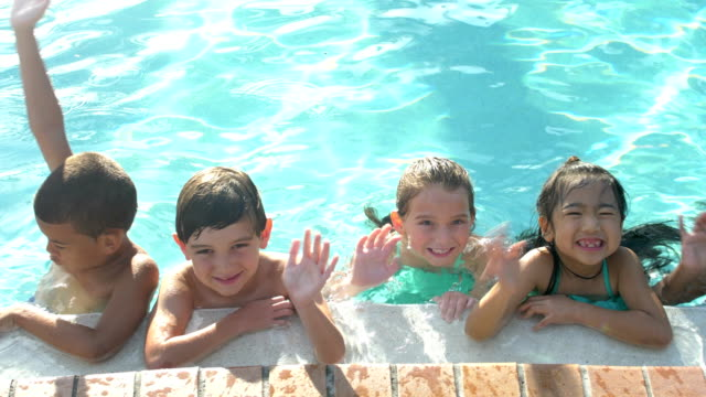 multi-ethnic children hanging on side of swimming pool - child waving stock videos & royalty-free footage