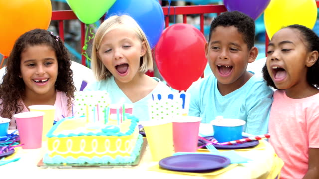 multi-ethnic children having fun at birthday party - 8 9 years stock videos & royalty-free footage