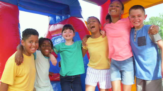 multi-ethnic children in a bounce house - 8 9 years stock videos & royalty-free footage