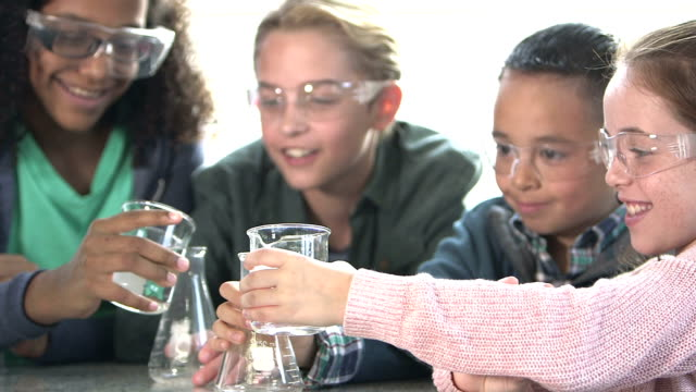 multi-ethnic children in chemistry lab - stem stock videos & royalty-free footage