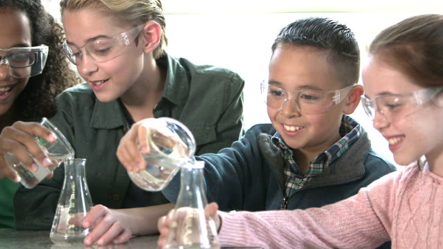 multi-ethnic children in chemistry lab - pre adolescent child stock videos and b-roll footage