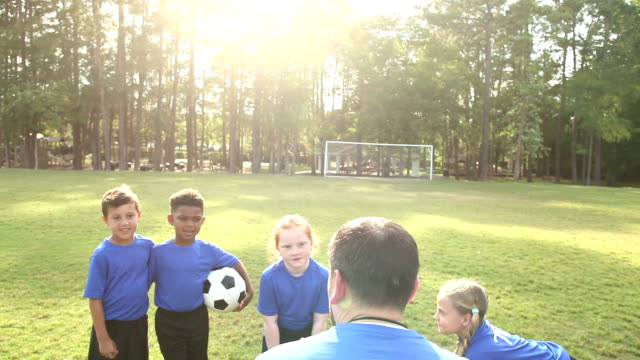 multi-ethnic children on soccer team listening to coach - 6 7 years stock videos & royalty-free footage