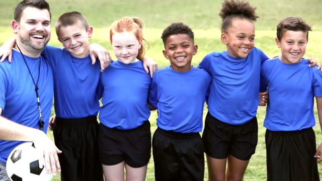 multi-ethnic children on soccer team with coach - 6 7 years stock videos & royalty-free footage