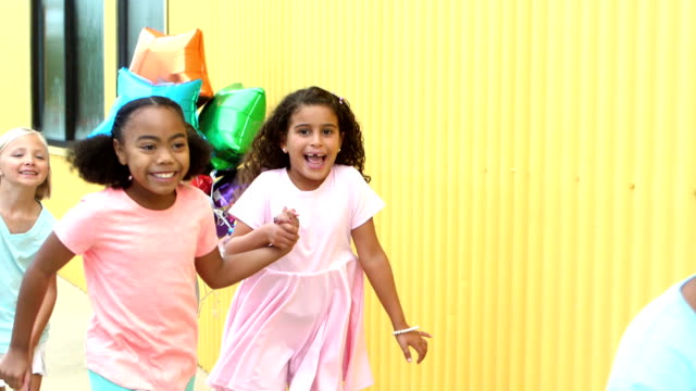 multi-ethnic children running together to party - 8 9 years stock videos & royalty-free footage