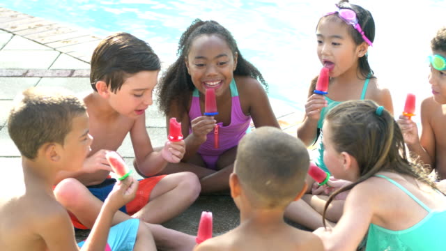 multi-ethnic children sitting in circle eating popsicles - girl cross legged stock videos & royalty-free footage