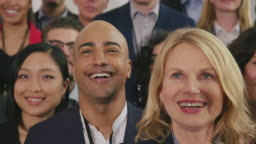 Multi-ethnic colleagues looking during a selfie
