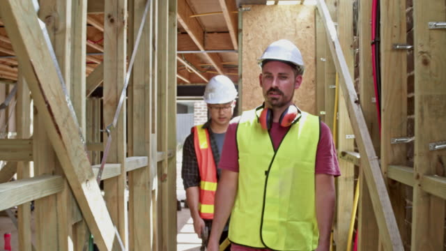multi-ethnic construction workers walking at construction site - trainee stock videos & royalty-free footage