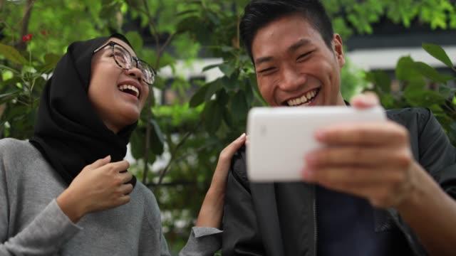 multiethnic couple having fun - malaysia stock videos & royalty-free footage