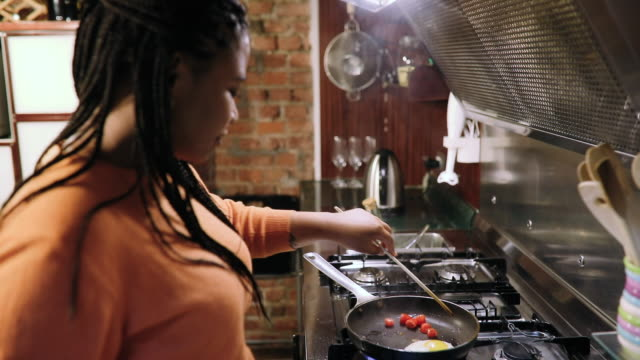 multi-ethnic couple of roommates preparing breakfast - cooking pan stock videos & royalty-free footage