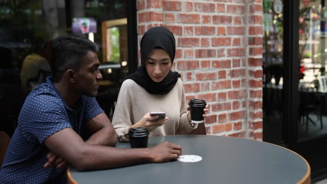 multi-ethnic couple out on a date - malayan ethnicity stock videos and b-roll footage