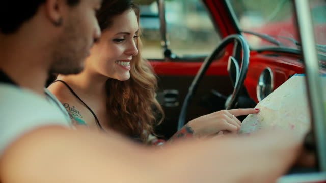 multiethnic couple talking in a vintage car - young couple stock videos & royalty-free footage
