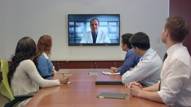 multi-ethnic doctors and professionals have video conferencing - presentation stock videos & royalty-free footage