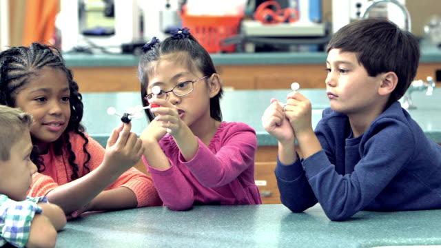 multi-ethnic elementary school children in science class - elementary school stock videos & royalty-free footage