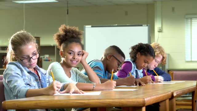 multi-ethnic elementary students in class taking test - 10 11 years stock videos & royalty-free footage