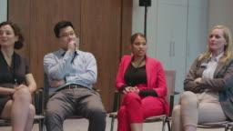 Multi-ethnic entrepreneurs attending conference