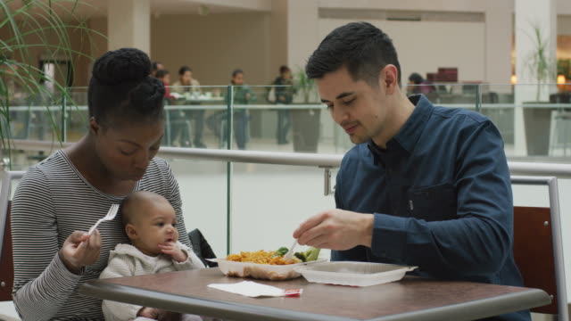 multi-ethnic family eating at a foodcourt table - food court stock videos and b-roll footage