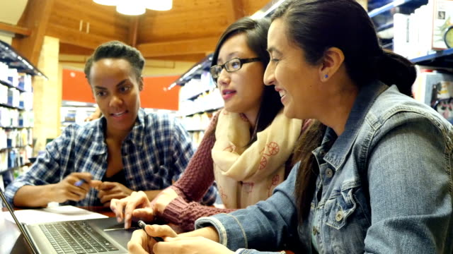 multi-ethnic female college students in study group brainstorm about assignment - denim jacket stock videos and b-roll footage