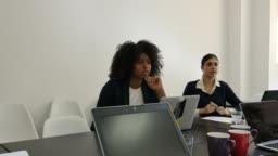 Multi-ethnic female executives planning strategy