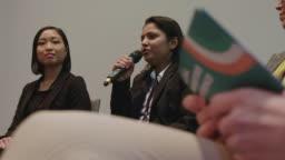 Multi-ethnic female expert panel during seminar